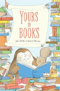 An owl and a squirrel read together amongst piles of books. Title: Yours in Books. Author: Julie Falatko, Illustrator: Gabriel Alborozo